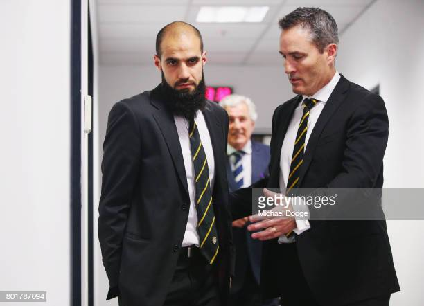 Bachar Houli of the Richmond Tigers leaves the AFL tribunal with Football Manager Tim Livingston on receiving a two week suspension for striking Jed...