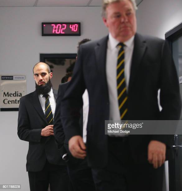 Bachar Houli of the Richmond Tigers leaves the AFL tribunal with Football Director Neale Balme on receiving a two week suspension for striking Jed...