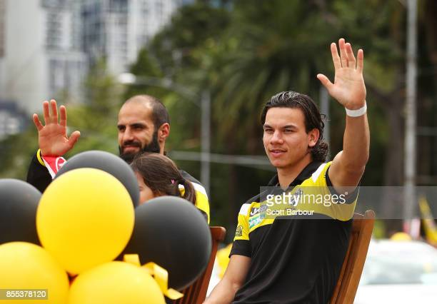Bachar Houli of the Tigers and Daniel Rioli of the Tigers wave to the crowd during the 2017 AFL Grand Final Parade on September 29 2017 in Melbourne...