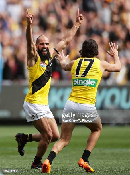 Bachar Houli of the Tigers celebrates a goal with Daniel Rioli of the Tigers during the 2017 AFL Grand Final match between the Adelaide Crows and the...