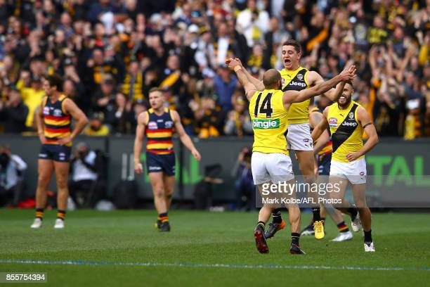 Bachar Houli of the Tigers congratulates Jason Castagna of the Tigers as he celebrates kicking a goal during the 2017 AFL Grand Final match between...