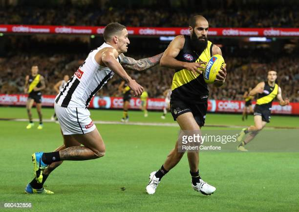 Bachar Houli of the Tigers controls the ball during the round two AFL match between the Richmond Tigers and the Collingwood Magpies at Melbourne...