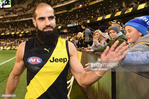 Bachar Houli of the Tigers high fives fans after winning the round 14 AFL match between the Richmond Tigers and the Carlton Blues at Melbourne...