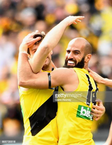 Bachar Houli of the Tigers is congratulated by team mates after kicking a goal during the 2017 AFL Grand Final match between the Adelaide Crows and...