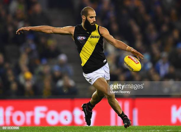 Bachar Houli of the Tigers kicks during the round 11 AFL match between the North Melbourne Kangaroos and the Richmond Tigers at Etihad Stadium on...