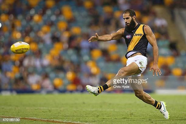 Bachar Houli of the Tigers kicks during the round three AFL match between the Brisbane Lions and the Richmond Tigers at The Gabba on April 18 2015 in...