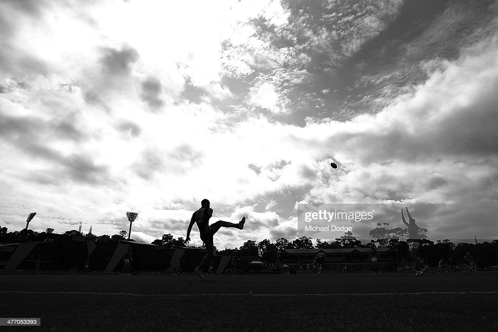 Bachar Houli of the Tigers kicks the ball during an AFL Practice Match between the Richmond Tigers and the Essendon Bombers at Punt Road Oval on March 7, 2014 in Melbourne, Australia.