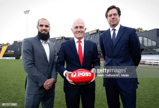 Bachar Houli of the Tigers Malcolm Turnbull Prime Minister of Australia and Gillon McLachlan Chief Executive Officer of the AFL pose for a photo...