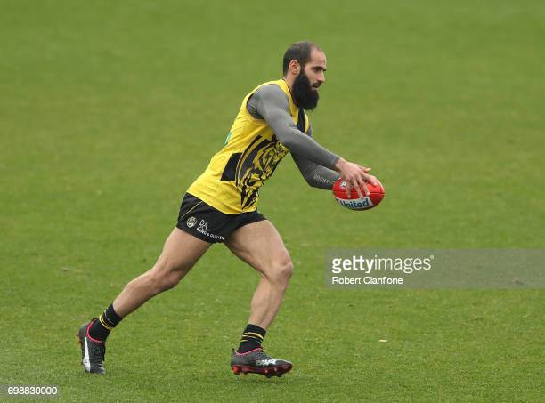 Bachar Houli of the Tigers runs with the ball during a Richmond Tigers AFL training session at Punt Road Oval on June 21 2017 in Melbourne Australia