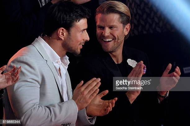 'Bachelor' participants Leonard Freier and Paul Janke react during the 4th show of the television competition 'Let's Dance' at Coloneum on April 8...