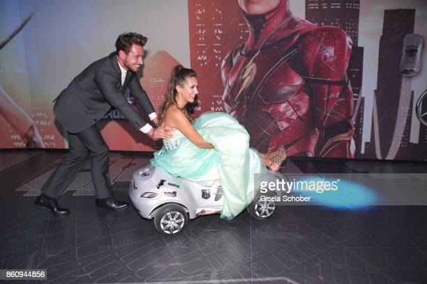 Bachelor Sebastian Pannek and his girlfriend CleaLacy Juhn drives a bobby car during the 'Tribute To Bambi' gala at Station on October 5 2017 in...