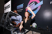 Bachelorette Ashley Hebert takes a spin on the table at the Durex Get InSync Party on June 21 2012 at Chrystie 141 in New York City