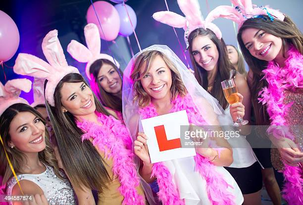 Bachelorettes holding a learning sign at a party