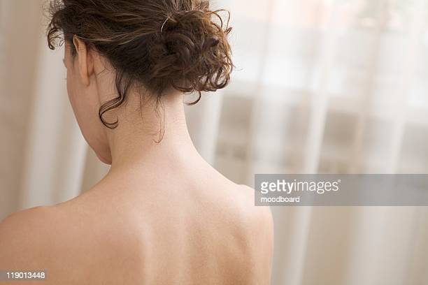 Back and shoulders of mid adult woman