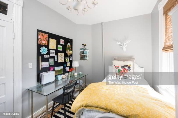A back bedroom of the Hoburg family's renovated Capitol Hill rowhouse also serves as a home office on July 26 2017 A Washington family makes a modest...