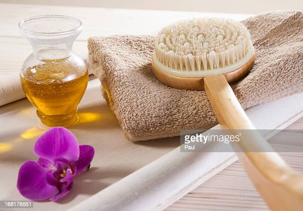 Back brush, towel and flower