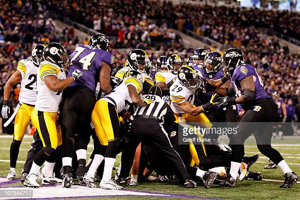 Back judge Greg Steed head linesman Greg Bradley and side judge Michael Banks break up a scuffle between the Baltimore Ravens and the Pittsburgh...