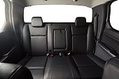 Back leather seat of modern pickup car interior with isolated windows