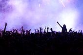 back lit crowd of hands at concert