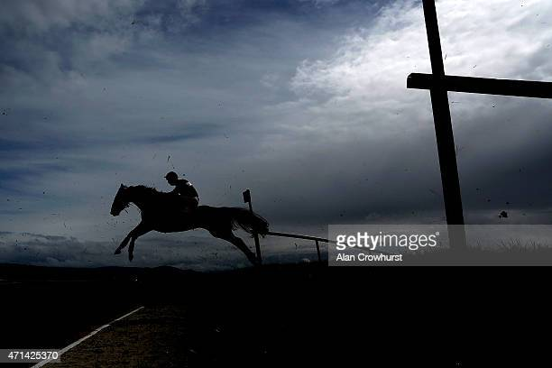A back marker clears the drop bank in The Kildare Hunt Club Fr Breen Memorial Steeple Chase at Punchestown racecourse on April 28 2015 in Naas Ireland