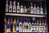 Back of a bar shelf through rippled glass