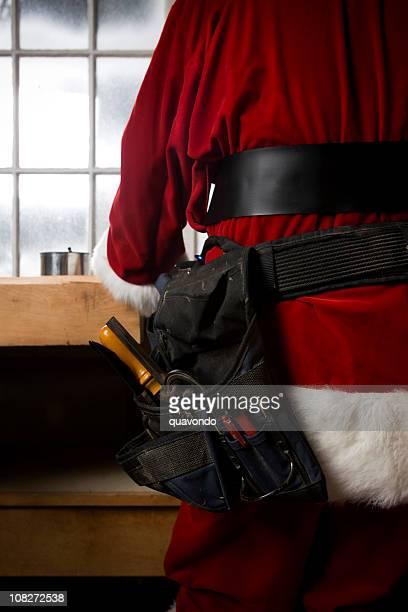 Dos de Santa Claus faisant des jouets dans l'Atelier, espace de copie