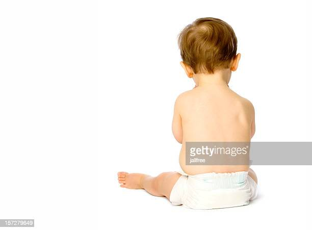 Back of small baby boy in nappy isolated on white