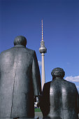 Back of Two Sculptures with Fernsehturm in the Distance