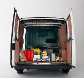 back of van with doors open and building materials