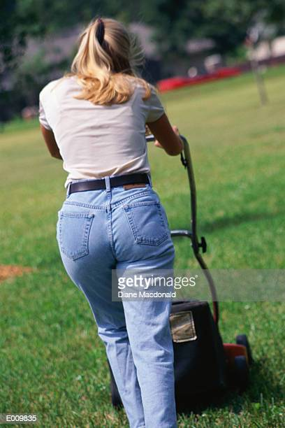 Back of woman mowing law