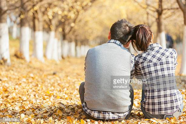 back of young couple in fall