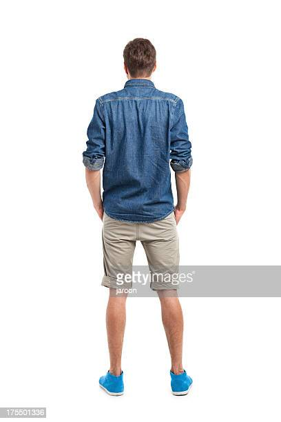 back of young handsome man in jeans shirt