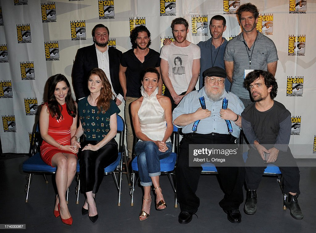 Back row (L-R) Actors John Bradley, Kit Harington, Richard Madden, writers D.B. Weiss, and David Benioff. Front row (L-R) Actors Emilia Clarke, Rose Leslie, Michelle Fairley, writer George R.R. Martin, and actor Peter Dinklage. during the 'Game Of Thrones' panel during Comic-Con International 2013 at San Diego Convention Center on July 19, 2013 in San Diego, California.