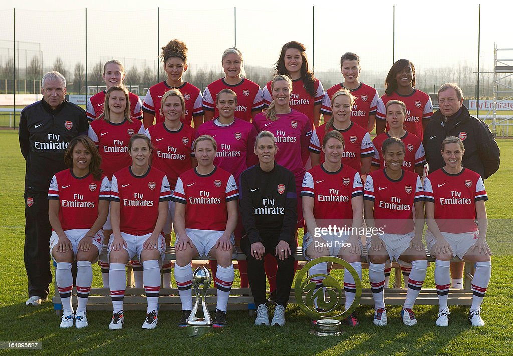 Back row (L-R) Kim Little, Jade Bailey, Steph Houghton, Jennifer Beattie, Niamh Fahey, Danielle Carter. Middle row (L-R) John Bayer (Assistant Manager), <a gi-track='captionPersonalityLinkClicked' href=/galleries/search?phrase=Ellen+White&family=editorial&specificpeople=4436830 ng-click='$event.stopPropagation()'>Ellen White</a>, Gilly Flaherty, Rebecca Spencer, Emma Byrne, Gemma Davison, Jordan Nobbs, Vic Akers (General Manager). Front row (L-R) Alex Scott, Yvonne Tracy, <a gi-track='captionPersonalityLinkClicked' href=/galleries/search?phrase=Jayne+Ludlow&family=editorial&specificpeople=3041449 ng-click='$event.stopPropagation()'>Jayne Ludlow</a>, Shelley Kerr (Manager), Ciara Grant, Rachle Yankey and <a gi-track='captionPersonalityLinkClicked' href=/galleries/search?phrase=Kelly+Smith+-+Soccer+Player&family=editorial&specificpeople=221581 ng-click='$event.stopPropagation()'>Kelly Smith</a>. Ladies photo shoot at Arsenal Training Ground on March 19, 2013 in St. Albans, Hertfordshire, England.