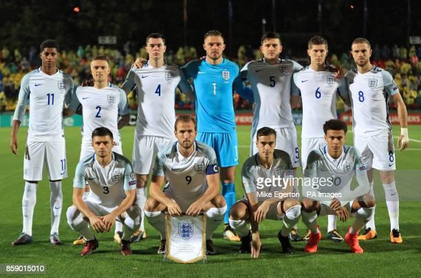 Back row left to right England's Marcus Rashford Kieran Trippier Michael Keane Jack Butland Harry Maguire John Stones and Jordan Henderson Front row...