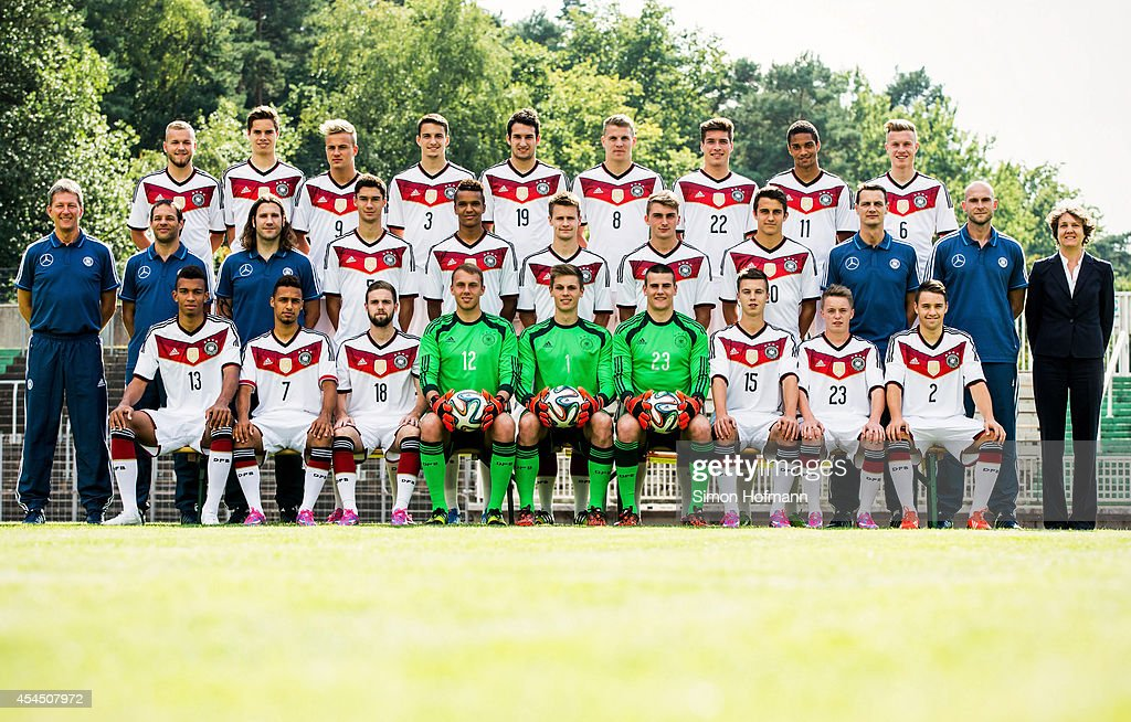 Back row (L-R) Pascal Koepke, Julian Weigl, Felix Lohkemper, Sebastian Stolze, Levin Mete Oeztunali, Tobias Pachonik, Thomas Hagn, Malcolm Cacutalua, Yannick Gerhardt; 2nd row (L-R) Head coach Frank Wormuth, Assistant coach Lars Deecke, Assistant coach Torsten Frings, Tim Kleindienst, Marian Sarr, Maximilian Guell, Maximilian Philipp, Marc Oliver Kempf, Fitness coach Ulf Sobek, Goalkeeper coach Christian Vander, Team manager Dagmar Pohlmann; front row (L-R) Kevin Akpoguma, Hany Mukhtar, Marc Stendera, Marvin Schwaebe, Daniel Mesenhoeler, Michael Zetterer, Jesse Weippert, Benjamin Truemner and Thomas Pledl pose during the team presentation of U20 Germany at Waldstadion on September 2, 2014 in Homburg, Germany.
