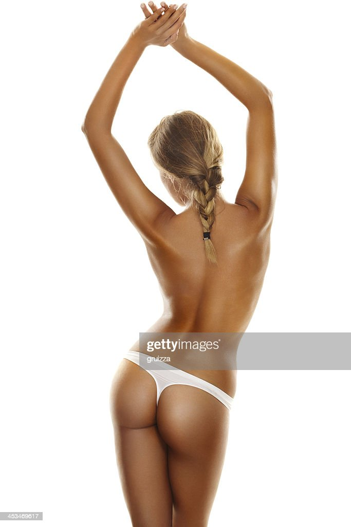 Back side view of a young, blonde woman's perfect body