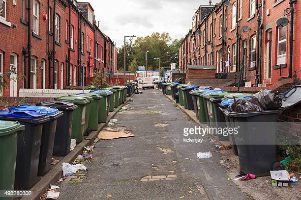 Back street full of rubbish and bins in Leeds