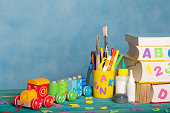 Back to school stationery is on the table.Blue sky coloured background
