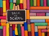 with colorful crayons and chalkboard