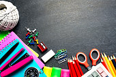School Supplies and Stationery on Blackboard Background - Back To School Concept.