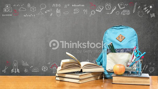 Back to school concept with school books, textbooks, backpack and stationery supplies on classroom desk with teacher's black chalkboard background with educational doodle for new academic year begin : Stock Photo