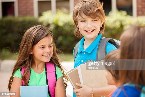 Back to School:  Elementary-age children, friends on school campus.