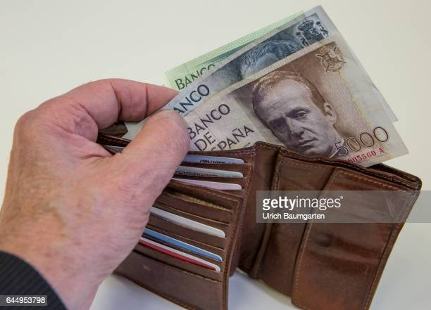 Back to the roots The picture shows spanish 5000 10000 and 1000 pesetas banknotes in a purse