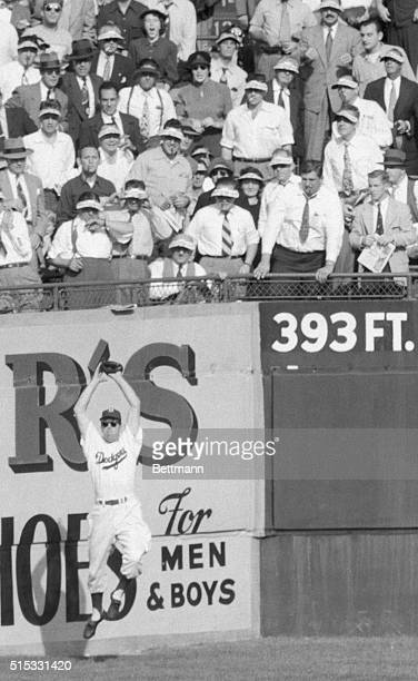 Back to the Wall Brooklyn New York Wearing sunglasses against a hot Brooklyn sun Dodgers' centerfielder Duke Snider leaps high with his back to the...