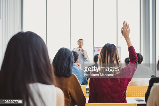 Back view business woman raising hand for asking speaker for question and answer concept in meeting room for seminar : Stock Photo