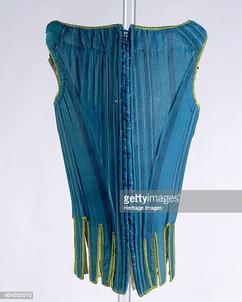 Back view of a corset c1670c1680 The back was made of darker material blue woven silk with patterned stripe