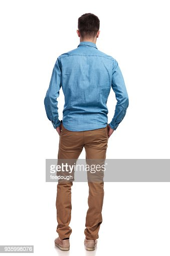 back view of a man standing with hands in pockets : Foto de stock
