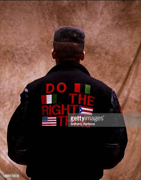 Back view of American film director Spike Lee as he poses in a jacket labelled 'Do the Right Thing' New York New York 1989