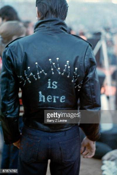 Back view of an unidentified man who wears a leather jacket that reads 'Sha Na Na Is Here' at the Woodstock Music and Arts Fair in Bethel New York...